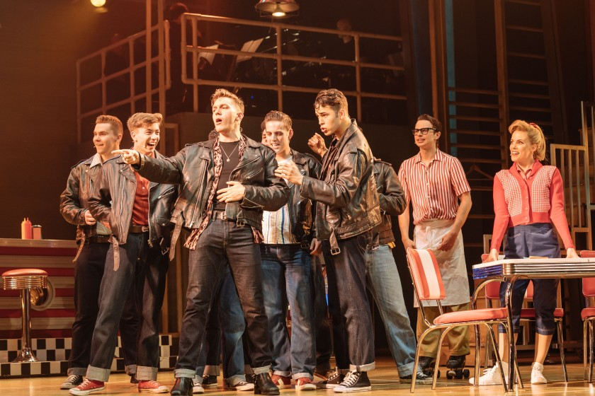 Dan Partridge as Danny & Louis Gaunt as Kenickie (front) and the T-Birds in the UK and Ireland tour of GREASE, credit Manuel Harlan